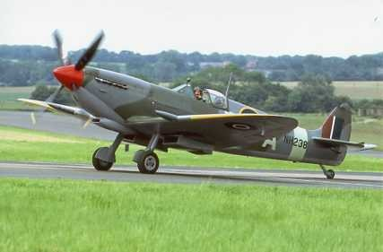 Colour Photograph of Spitfire  Mk. IXc NH238 taxiing